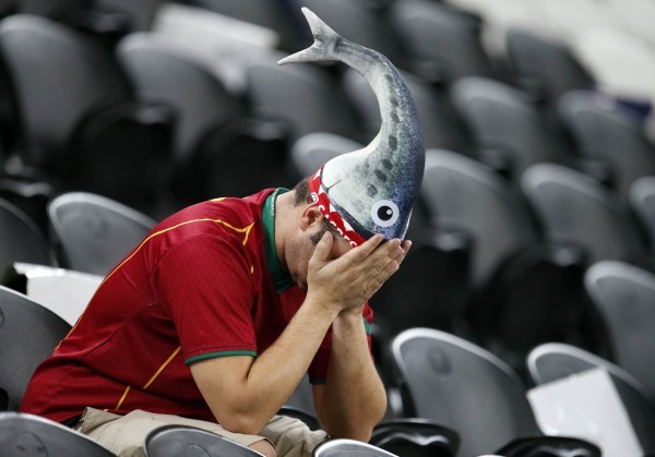 A Portuguese fan sits dejected after the Euro 2012 soccer championship semifinal match between Spain and Portugal in Donetsk, Ukraine on Thursday, June 28, 2012.
