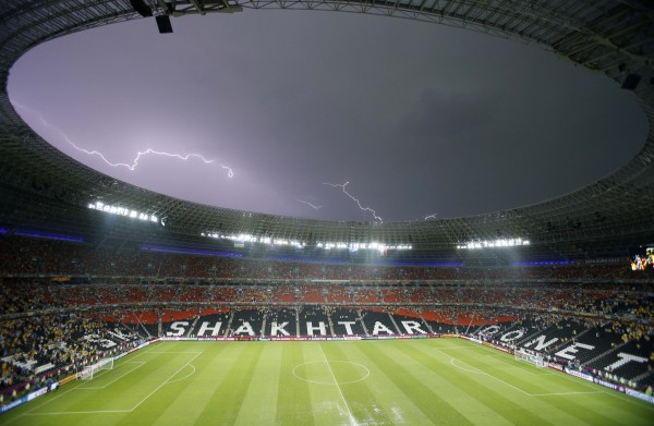 Lightning flashes over the stadium after the weather suspended the Euro 2012 soccer championship Group D match between Ukraine and France in Donetsk, Ukraine on Friday, June 15, 2012.