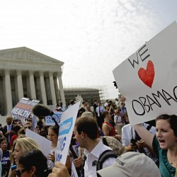 Supporters of President Barack Obama's health care law celebrate outside the Supreme Court in Washington on Thursday, June 28, 2012, after the court's ruling was announced.