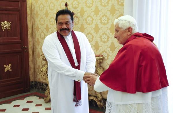 Pope Benedict XVI meets Sri Lankan President Mahinda Rajapaksa in his private library at the Vatican Friday, June 8, 2012.
