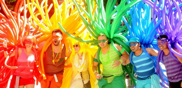 Revelers with balloons create a human rainbow during San Francisco's 42nd annual Gay Pride Parade on Sunday, June 24, 2012. The sidewalks of downtown San Francisco were crowded with colorful revelers on Sunday as the city marked its 42nd year celebrating the lesbian, gay and transgender community.