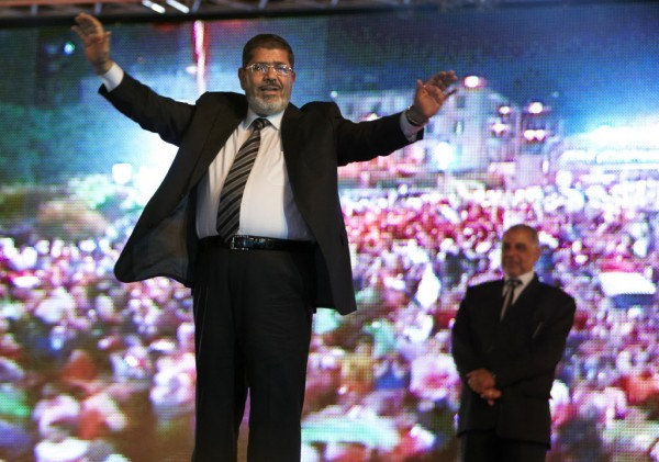 In this Sunday, May 20, 2012 file photo, the Muslim Brotherhood's presidential candidate Mohammed Morsi hold a rally in Cairo, Egypt. Egypt's electoral commission announced Sunday, June 24, 2012 that Morsi is victor of landmark presidential vote.