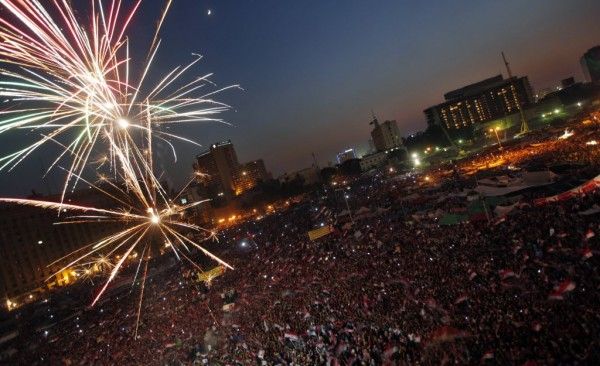 Fireworks illuminate Tahrir Square in Cairo, Egypt, as Egyptians gather to celebrate Mohammed Morsi's presidential win Sunday, June 24, 2012. Mohammed Morsi was declared Egypt's first Islamist president on Sunday after the freest elections in the country's history, narrowly defeating Hosni Mubarak's last Prime Minister Ahmed Shafiq in a race that raised political tensions in Egypt to a fever pitch.