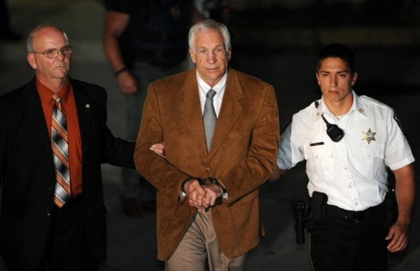 Jerry Sandusky is led from the Centre County Courthouse in Bellefonte, Pennsylvania, after being found guilty of 45 counts of sexual abuse, Friday, June 22, 2012.