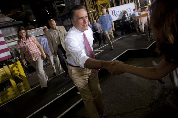 Republican presidential candidate, former Massachusetts Gov. Mitt Romney shakes hands during a campaign stop at Seilkop Industries in Cincinnati, Ohio, Thursday, June 14, 2012.