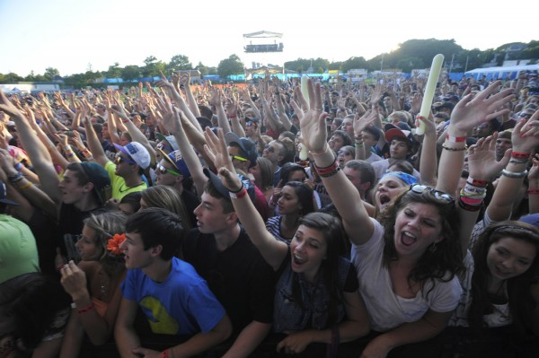 The crowd moves and grooves to the Minneapolis-based hip-hop group Atmosphere during their performance at the KahBangor Festival in 2011.