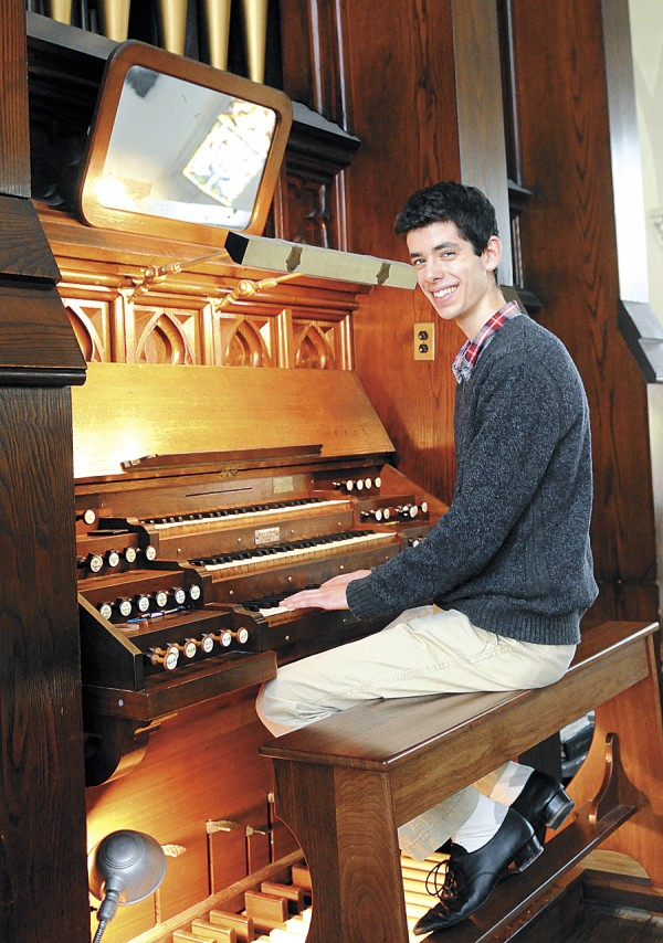 Abraham Ross of Holden sits at the 1860 Elias & George G. Hook pipe organ located at St. John's Catholic Church in Bangor. An accomplished organist, Ross took lessons on this same organ from Dr. Kevin Birch. The College of the Holy Cross in Worcester, Mass. has awarded Ross an organ scholarship; while studying music at Holy Cross, he will pursue his private studies on the organ.