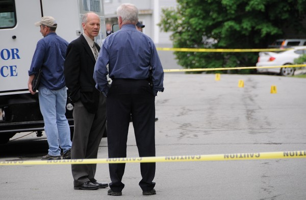 Bangor Police Chief Ron Gastia (left) and Lt. Tim Reid confer as they join other department members in investigating the area of a fatal stabbing on First Street in Bangor that took place on May 22, 2012.