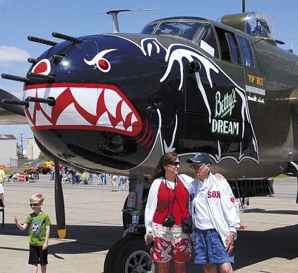 "During the Texas Flying Legends' air show held at Bangor International Airport on Sunday, June 17, Elizabeth Stevens of Bangor posed for photos with 91-year-old Larry Van Peursem of Brewer. They stood in front of a B-25J Mitchell nicknamed ""Betty's Dream."" Van Peursem flew B-25s during World War II."