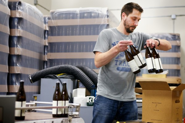 Brewer Kevin Glessing boxes up freshly labeled bottles of Peeper Ale at Maine Beer Co. Wednesday, June 6, 2012, in Portland. The Maine Beer Company is off Riverside Street, within a stone's throw of several other craft breweries.