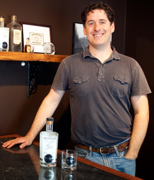 Ned Wight owns New England Distilling in Portland, where they make Ingenium brand gin. His facility, in a business park off Riverside Street, is near a handful of craft beer breweries.