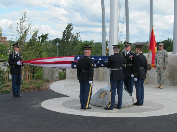 The Maine Honor Guard raises the colors during the grand opening ceremony for the new Veterans Memorial Bridge connecting Portland with South Portland Thursday, June 28, 2012.