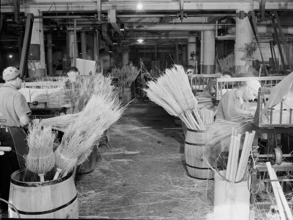 For a household item essentially perfected in its design so many decades ago, the broom's staying power -- both as a cleaning tool and cultural symbol of neat domestic tranquility -- is remarkable and deserved. A 1944 New York broom production facility for the Army and Navy.