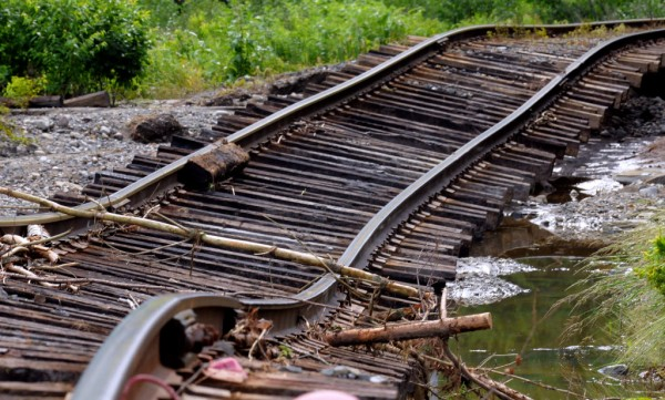 Floodwaters washed away the gravel from several sections of the railroad tracks in Brownville. A storm dropped about eight inches of rain, causing extensive flooding and washouts in the area.