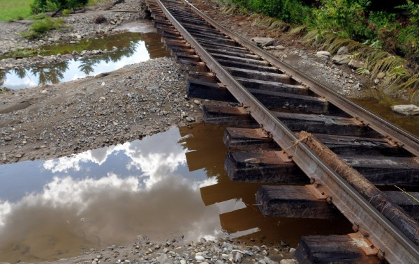 Floodwaters washed away the gravel from several sections of the railroad tracks in Brownville. A storm dropped about eight inches of rain overnight, causing extensive flooding and washouts in the area.