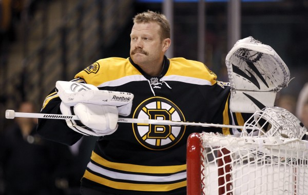 Boston Bruins goalie Tim Thomas gets ready for a game between the Bruins and the Pittsburgh Penguins in Boston in February.