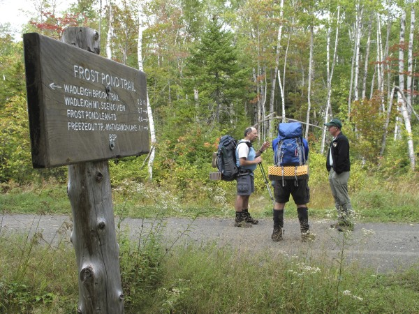 Baxter State Park director Jensen Bissell (right) talks with hikers Larry Donoghue (left) and Michael Saporito, both of Massachusetts, who were crossing a road in the Scientific Forest Management Area in September 2009.