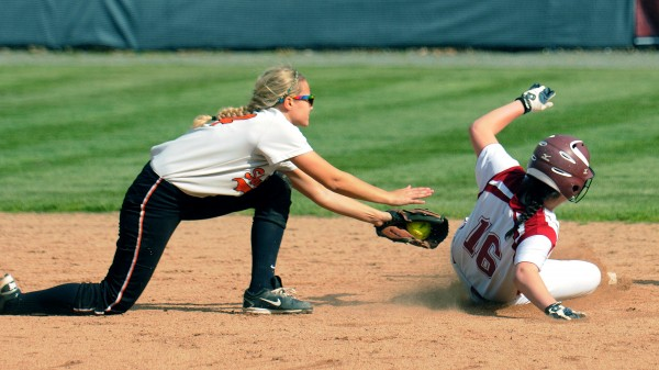 Skowhegan High School's Amanda Johnson (left) can't tag Bangor High School's Carly Cosgrove, allowing her to reach second base during the quarterfinal game in Bangor Thursday.