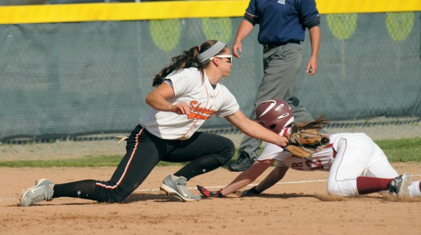 Skowhegan High School's Shelby Obert (left) tags Bangor High School's Annie Guare at third base during the quarterfinal game in Bangor Thursday.