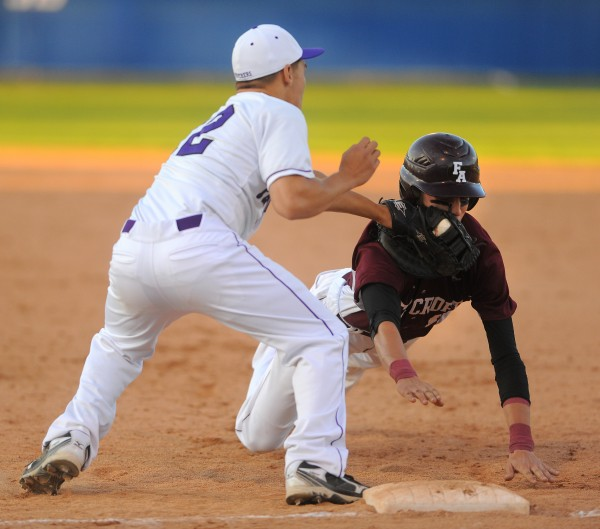 Foxcroft Academy's Kaleb Smith (right) is picked off at first base by Waterville High School's Tyler Bouchard during the Eastern Maine Class B final game in Bangor Thursday.