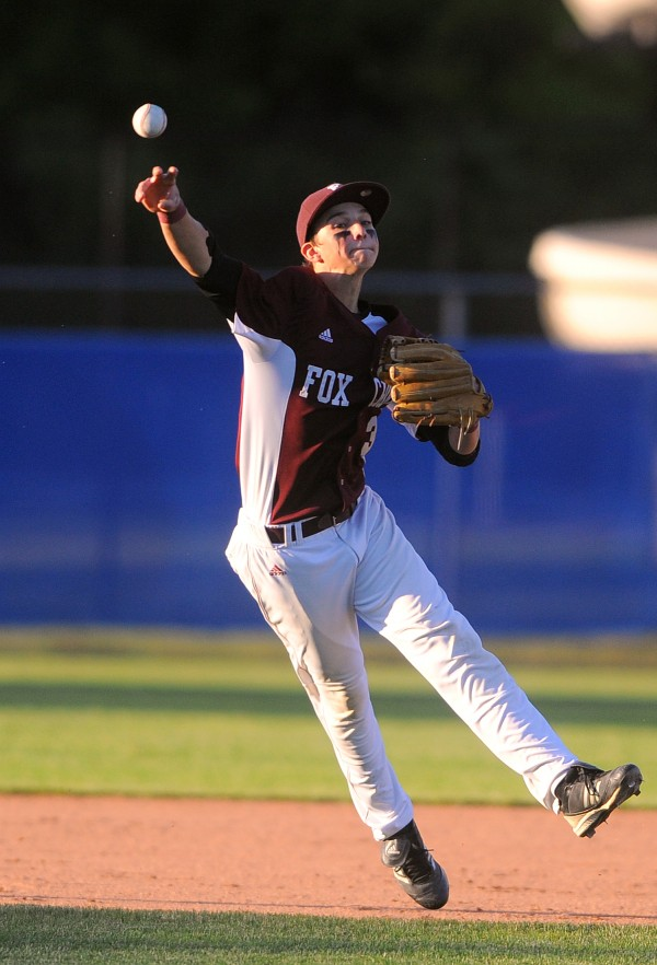 Foxcroft Academy's Caleb Richard throws the ball to first base during the Eastern Maine Class B final game against Waterville High School in Bangor Thursday.