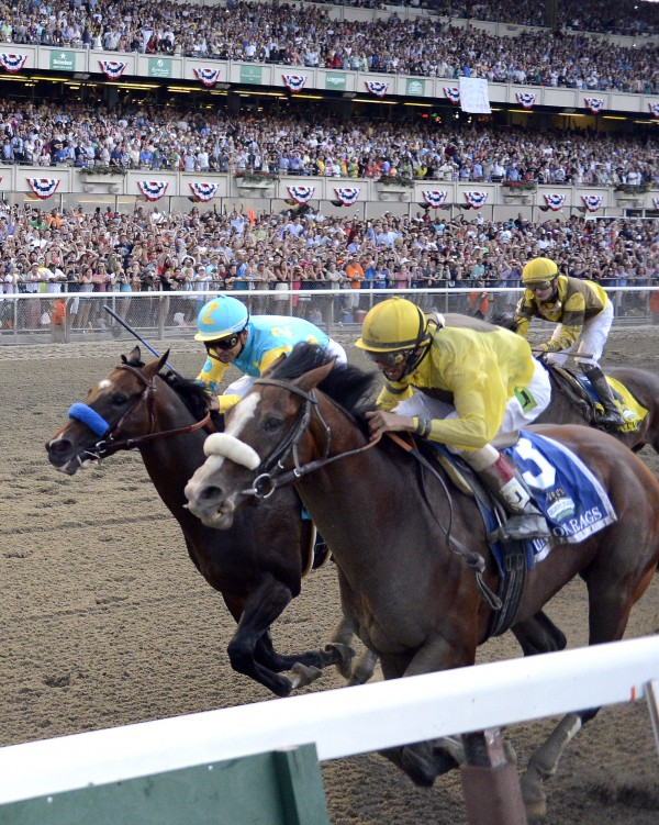 Union Rags, right, with jockey John Velazquez, eases ahead of Paynter, with Mike Smith riding, to win the Belmont Stakes horse race in Elmont, N.Y., Saturday, June 9, 2012.