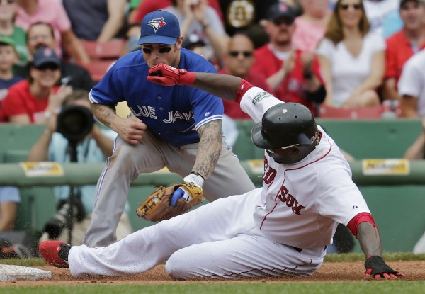 Boston Red Sox's David Ortiz beats the tag by Toronto Blue Jays' third baseman Brett Lawrie as he advances on a double by teammate Cody Ross in the fourth inning of a baseball game at Fenway Park in Boston on Wednesday, June 27, 2012.