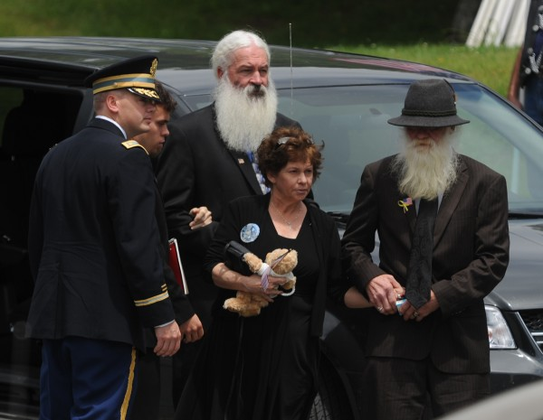Family members of John &quotJay&quot Brainard arrive at St. Anne's Roman Catholic Church in Dexter on Saturday, June 16, 2012 for the military funeral of Brainard who was killed when his Apache helicopter crashed in Afghanistan on Memorial Day.