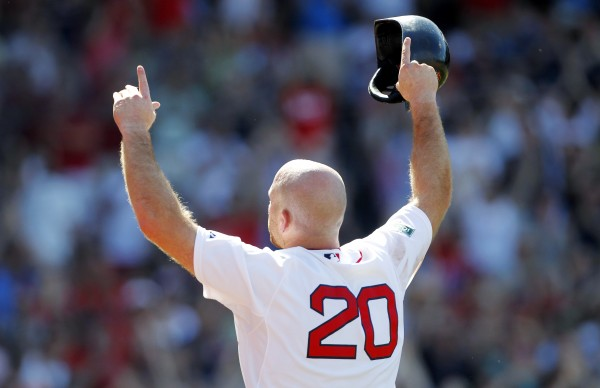 Boston Red Sox's Kevin Youkilis (20) raises his arms to the crowd as he comes off the field after hitting a triple and being replaced with a pinch-runner in the seventh inning of a baseball game against the Atlanta Braves in Boston, Sunday, June 24, 2012.