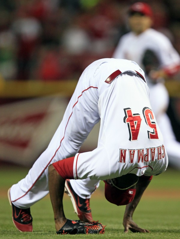 Cincinnati Reds relief pitcher Aroldis Chapman performs a somersault after defeating the Milwaukee Brewers 4-3 in a baseball game on Tuesday, June 26, 2012, in Cincinnati. Chapman recorded his ninth save.