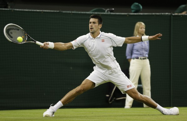 Novak Djokovic of Serbia returns a shot against Ryan Harrison of the United States  during a second round men's singles match at the All England Lawn Tennis Championships at Wimbledon, England on Wednesday, June 27, 2012.