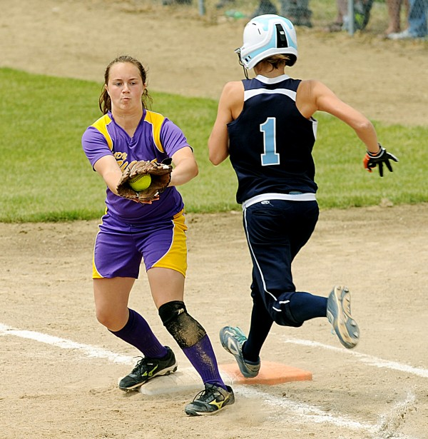 Bucksport's Sadie Wight gets the ball one half step before Dirigo's Alyssa Wade hits first base in the Class C State Softball Championship on Saturday, June 16, 2012, at Saint Joseph's College in Standish. The Golden Bucks topped the Cougars 2-0.