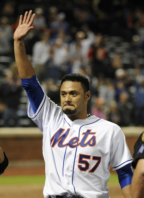 New York Mets starting pitcher Johan Santana (57) celebrates his no-hitter against the St. Louis Cardinals on Friday, June 1, 2012, at Citi Field in New York. The Mets won 8-0.