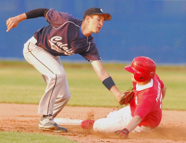 Dexter High's Trevor Fogarty (7) is tagged out trying to steal second base by Calais High's Jeremy Beers (2) at Mansfield Stadium in Bangor on Tuesday evening.