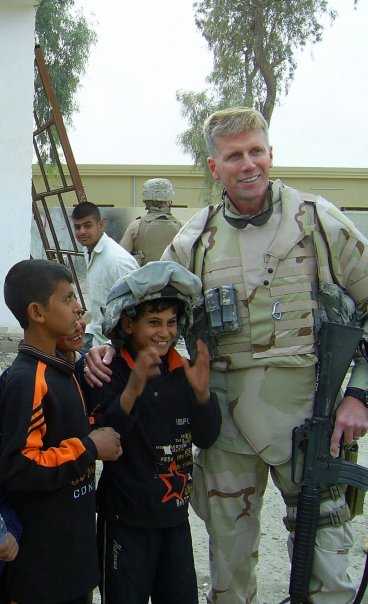 Republican U.S. Senate candidate Charlie Summers poses with kids while on military duty in this photo from his Facebook page.