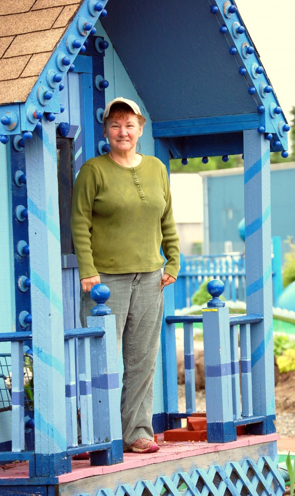 Perched on the porch of a miniature cottage that is among many whimsical elements of Wild Blueberry Land's new minigolf course, Maria Emerson surveys the vegetable plantings that serve up edible rewards for those who shoot par or below.