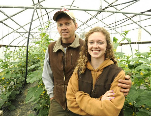 Doug Chipman stands with his daughter, Tomi, in one of their greenhouses in Poland. Tomi, a student at Bates College, plans to follow in her father's footsteps and be a farmer.
