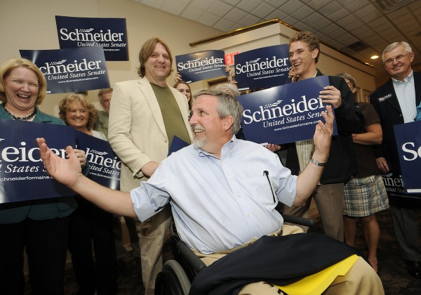 U.S. senate candidate Bill Schneider (R) of Durham is greeted by family, friends and supporters as he arrives at his campaign headquarters at the Ramada Conference Center in Lewiston on Tuesday.