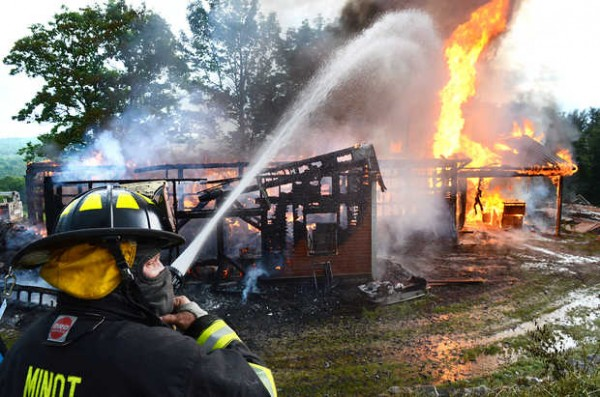 A large barn that doubled as a workshop on Patten Hill Road was hit by lightning Friday evening and burned out of control.
