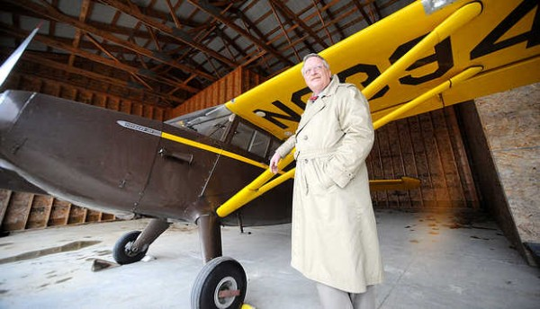 Dr. Louis Hanson of Durham stands with his plane, Isabelle, a 1946 Stinson Voyager that once made international news when her owner detached her wings and deployed a parachute, for a Sun Journal feature about the doctor and his plane in November 2010.