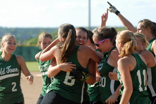 The Old Town Coyotes celebrate their 4-1 victory over Fryeburg Academy in the Class B State Championship game Saturday afternoon, June 16, 2012 at Coffin Field in Brewer.
