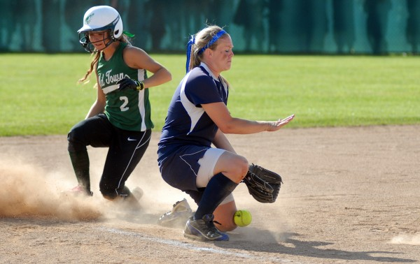 Old Town's Rachel Martin is safe on third base by Fryeburg Academy's Maggie McConkey in the sixth inning of the Class B State Championship game Saturday afternoon, June 16, 2012 at Coffin Field in Brewer. Old Town won the game 4-1.