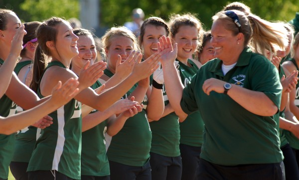 The Old Town Coyotes' head coach celebrates with her team after their 4-1 victory over Fryeburg Academy in the Class B State Championship game Saturday afternoon, June 16, 2012 at Coffin Field in Brewer.