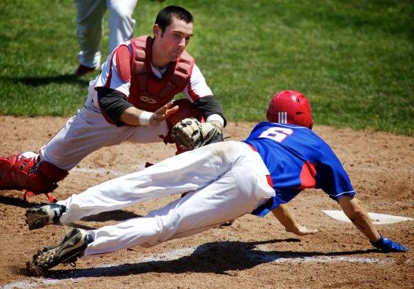 Scarbrough High School catcher Connor McCann tags Messalonskee High School third baseman Travis St. Pierre out at the plate Saturday, June 16, 2012 in Standish during the State Class A Baseball Championship Game.