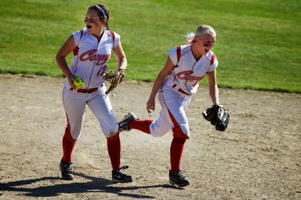 Cony High School players Alyssah Dennett (left) and Alyssa Brochu start to celebrate after winning the State Class A Softball Championship Game in Standish  on Saturday, June 16, 2012.