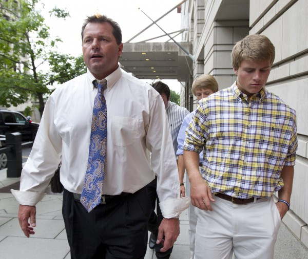 Roger Clemens (left) leaves federal court in Washington with son Kacy (right) Tuesday, June 12, 2012.