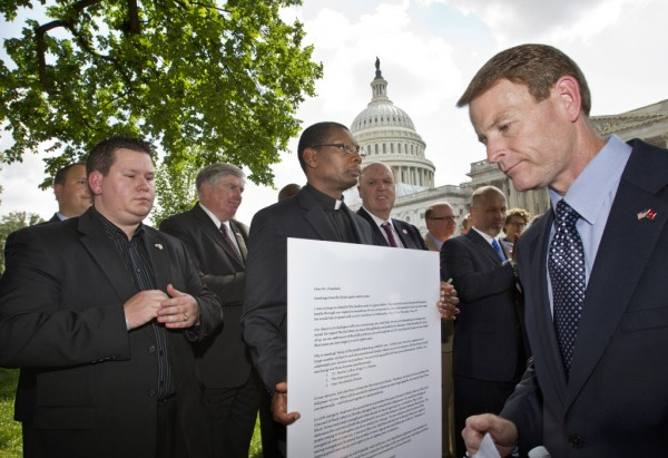 Family Research Council President Tony Perkins, right, finishes his speech denouncing gay marriage as a group of pastors from across denominational lines gather on Capitol Hill in Washington, Thursday, May 24.