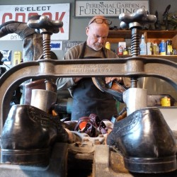 Carleton Leavitt, who owns the new cobbling shop Kiss My Boots in Hope, worked on re-soleing a pair of men's leather shoes recently.