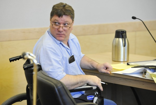 Seated in his wheelchair, Jeffrey Cookson turns toward the gallery at the close of a hearing for Cookson at Penobscot Judicial Center on Wednesday, Aug. 31, 2011. Cookson, 47, is serving consecutive life sentences at the Maine State Prison for the slaying in December 1999 of his ex-girlfriend Mindy Gould, 20, and the boy she was babysitting, Treven Cunningham, 21 months old, both of Dexter.