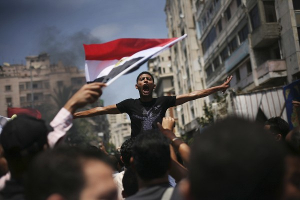 An Egyptian protester chants slogans against presidential candidate Ahmed Safiq during a demonstration against the Supreme Constitutional Court rulings in Alexandria, Egypt on June 15, 2012. Judges appointed by Hosni Mubarak dissolved the Islamist-dominated parliament Thursday and ruled his former prime minister eligible for the presidential runoff election this weekend, setting the stage for the military and remnants of the old regime to stay in power.
